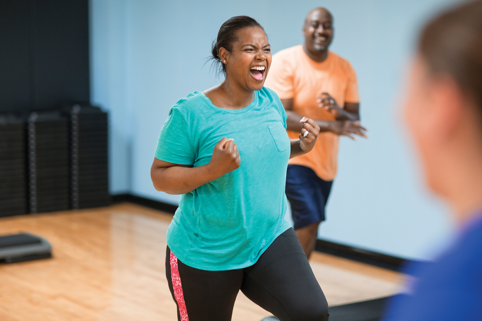 Exciting woman in fitness class